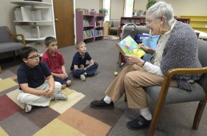 Deacon Helen reads at Learning Perch